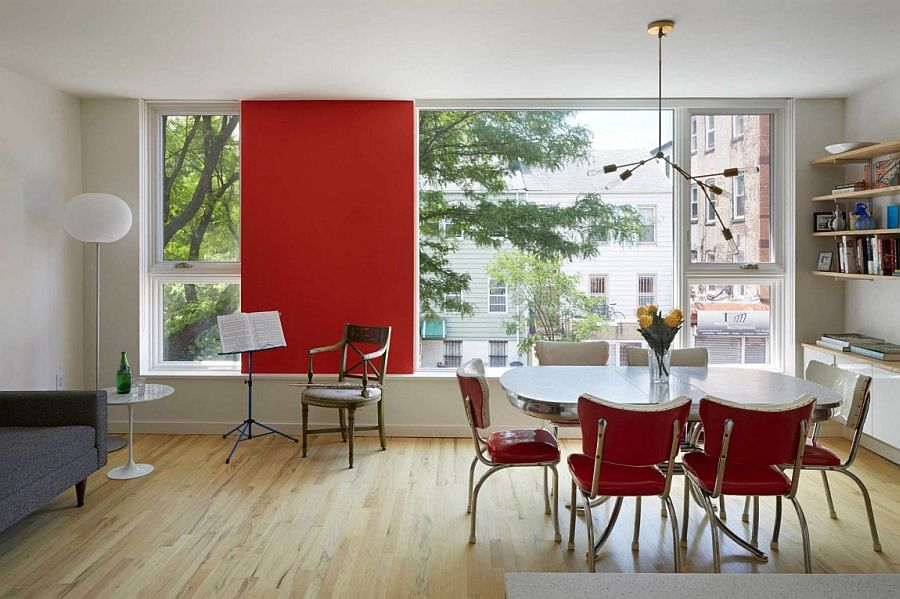 Pops of red enliven both the interior and extreior of the home