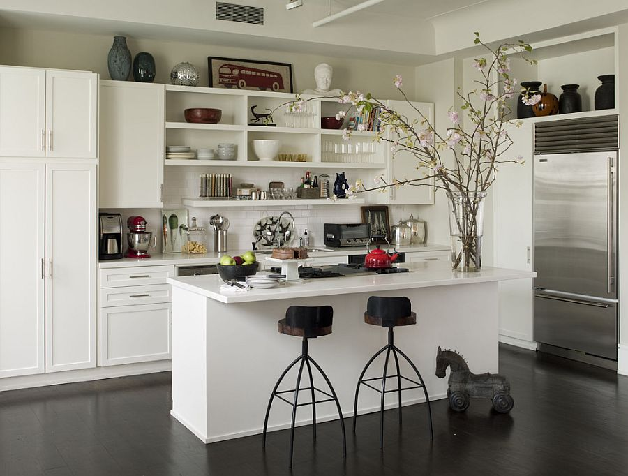 Practical kitchen wall with open shelves, closed cabinets and a spice rack [Design: Thom Filicia]