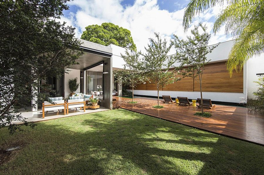 Private garden and wooden deck extend the living space outdoors