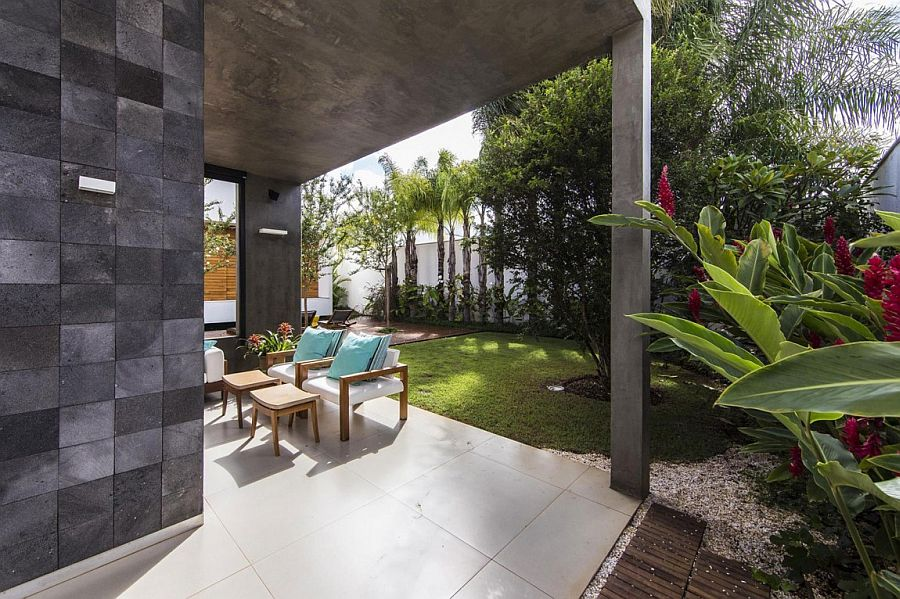 Raw concrete structure of the Brazilian home acts as an extended pergola