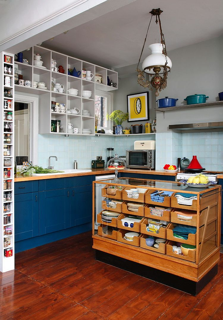 Reclaimed vintage haberdasher turned into a unique island for the eclectic kitchen [From: Alison Hammond Photography]