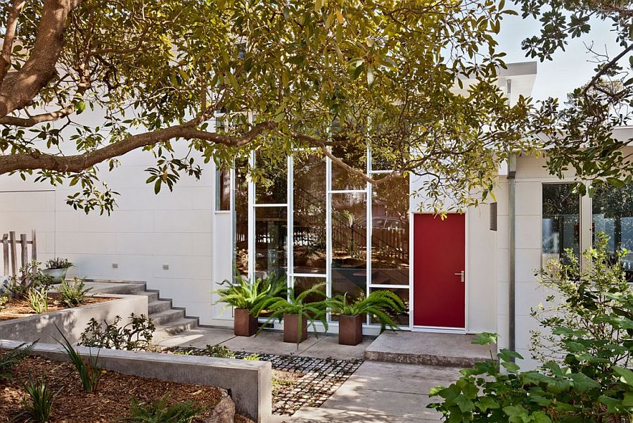 Red door of the Mid-century home adds color to the entrance