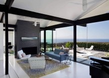 Retractable sliding glass doors open up the contemporary living area