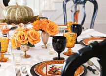 Romantic Halloween table setting with orange roses 217x155 20 Halloween Inspired Table Settings to Wow Your Dinner Party Guests