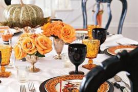 Romantic Halloween table setting with orange roses