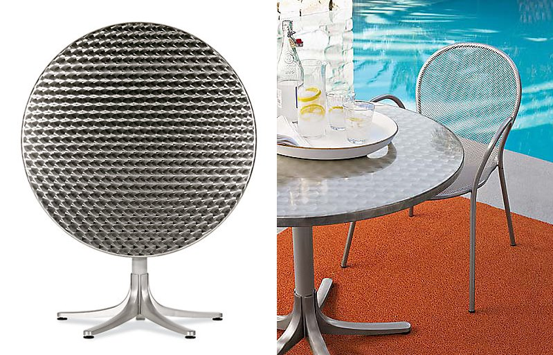 Round stainless steel dining table from Design Within Reach