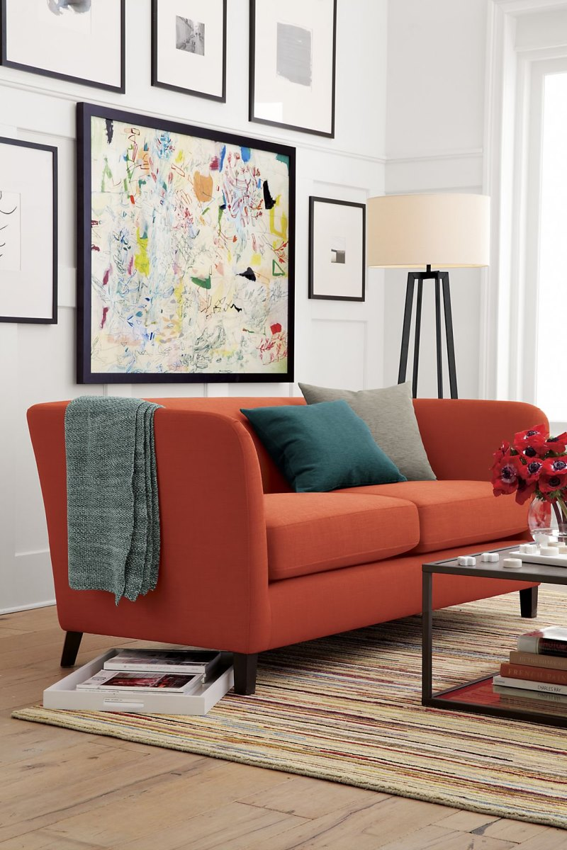 Rust and teal in a living room by Crate & Barrel