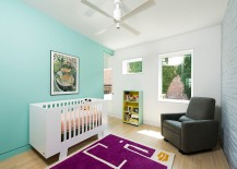 Scandinavian nursery with turquoise accent wall, brick wall and purple rug