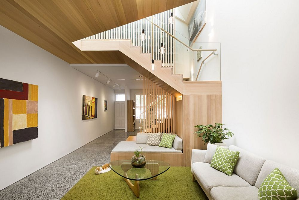 Sculpted timber stair becomes the focal point of the revamped living room