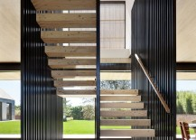 Sculptural steel and wooden staircase of the barn-style home