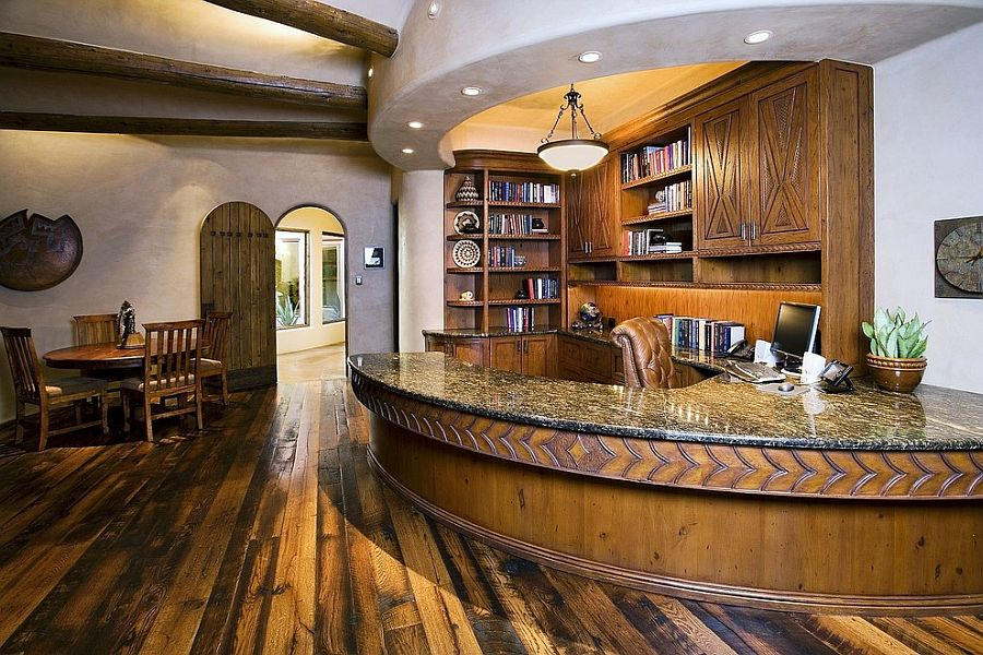 Sensational home office with custom curved desk and ceiling design [Design: Design Barbarians Architects]