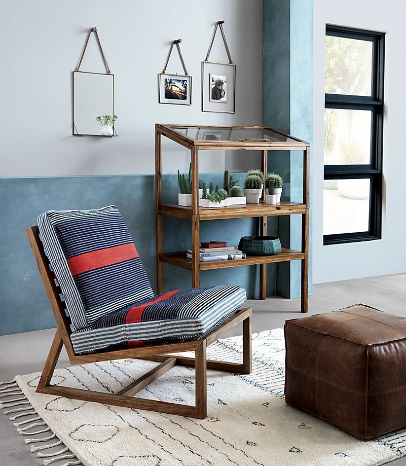 Shades of blue and orange on a wooden lounger from CB2
