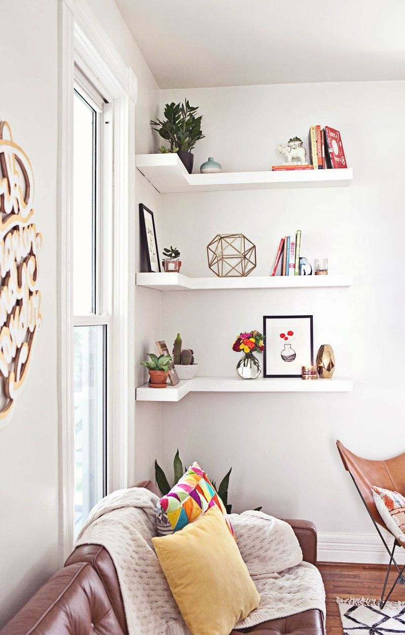 Shelf styling in the living room of A Beautiful Mess