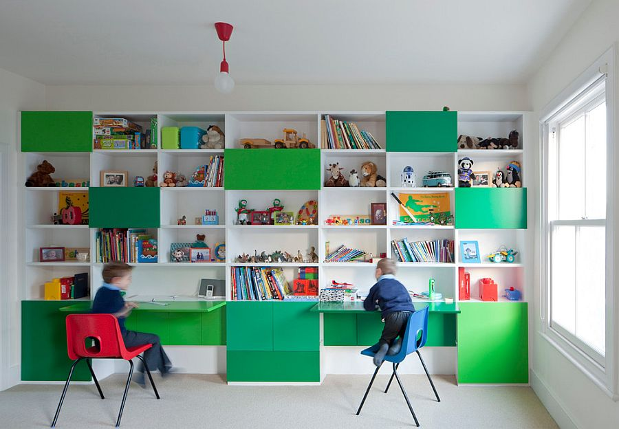 Shelves and workstation in kids' room with multiple shades of green [Design: Paul Archer Design]
