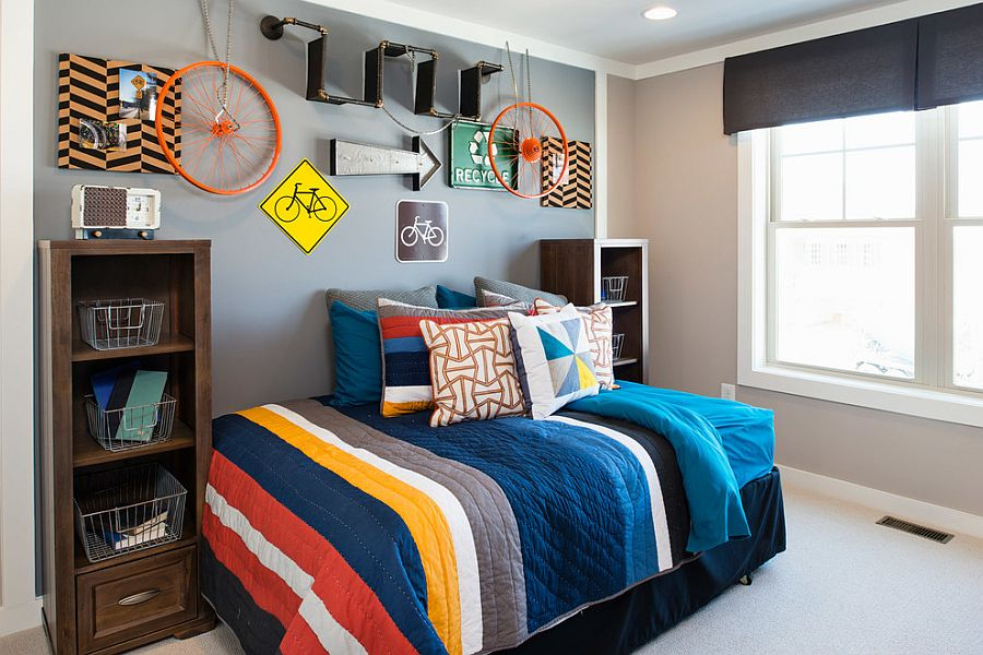 Signs on the wall and orange bicycle wheels used to decorate kids' room [Design: Laura Manning Bendik]