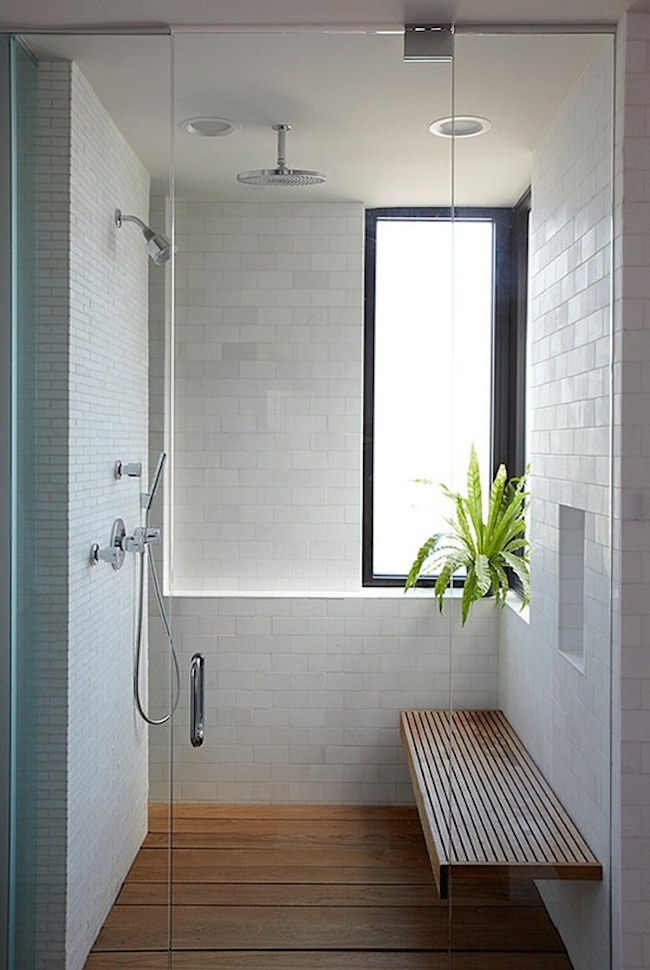 Simple but large shower with wood bench