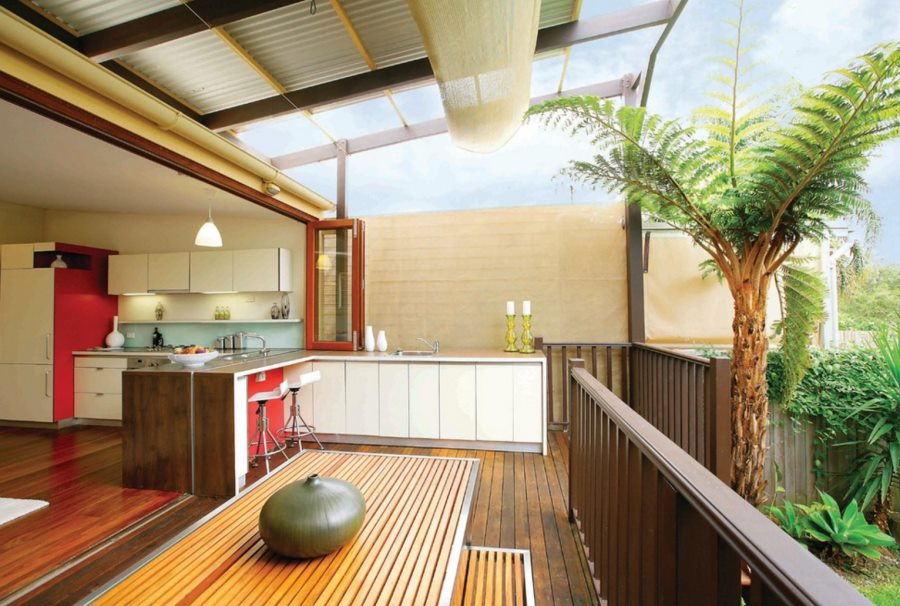 Slatted dining table and bench on a modern deck