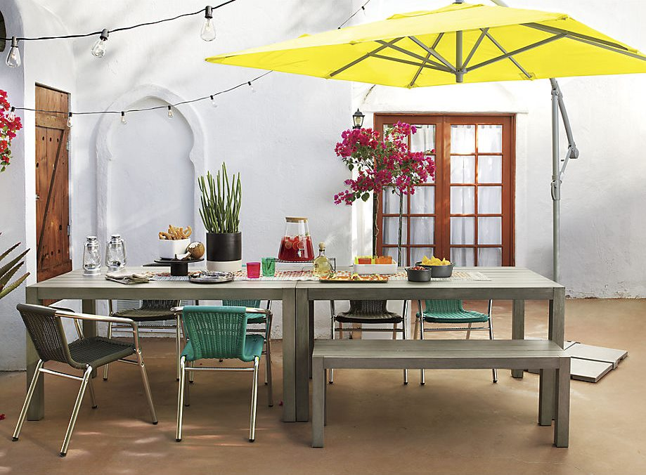 Slatted dining tables and bench from CB2