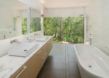 Sleek bathroom overlooking the trees