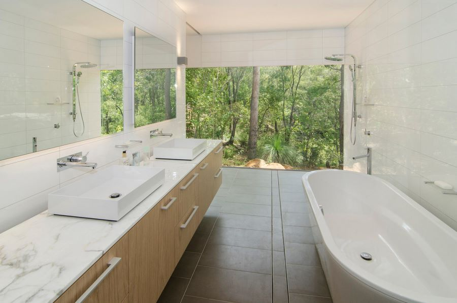 Sleek bathroom overlooking the trees  Spectacular Bathroom Design with a View Sleek bathroom overlooking the trees