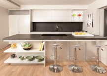 Sleek-kitchen-island-is-perfect-for-classy-contemporary-kitchen-217x155