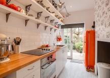Small-city-apartment-kitchen-with-pops-of-orange-217x155