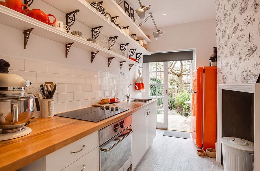 Small city apartment kitchen with pops of orange