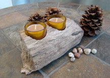 Small natural piece of beach driftwood holding two candles