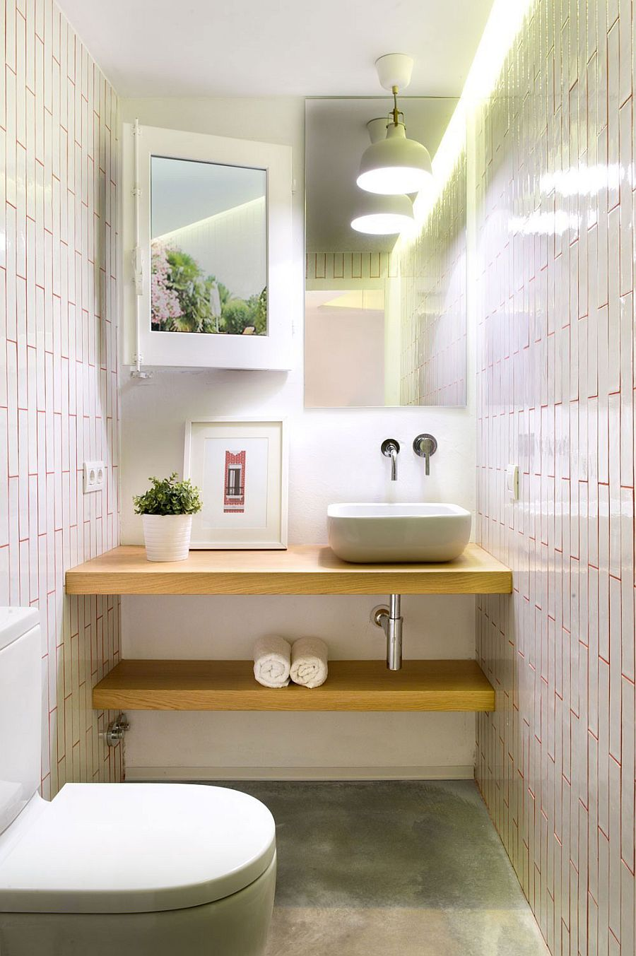 Small powder room with floating wooden shelves