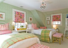 Snazzy teen bedroom with wallpaper on the walls and pops of pink