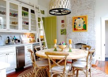 Spacious-kitchen-with-whitewashed-fireplace-and-dining-space-217x155