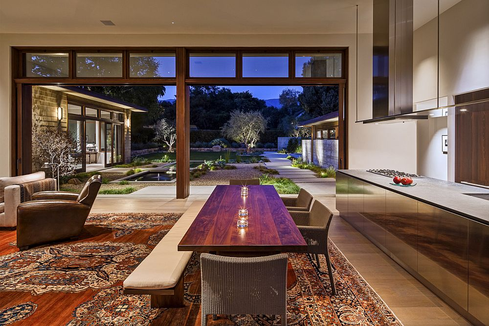 Sparkling dining area and living zone connected with the landscape outside