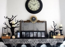 Spooky black cobweb Halloween decor for a fireplace mantel