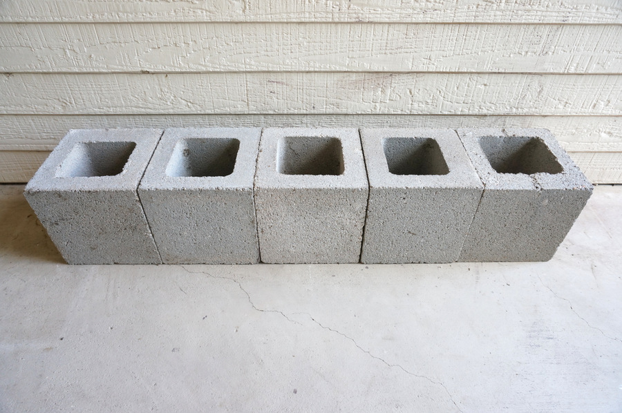 Stack five cinder blocks in a row
