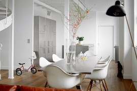 Stainless steel dining table complements the style of the kitchen
