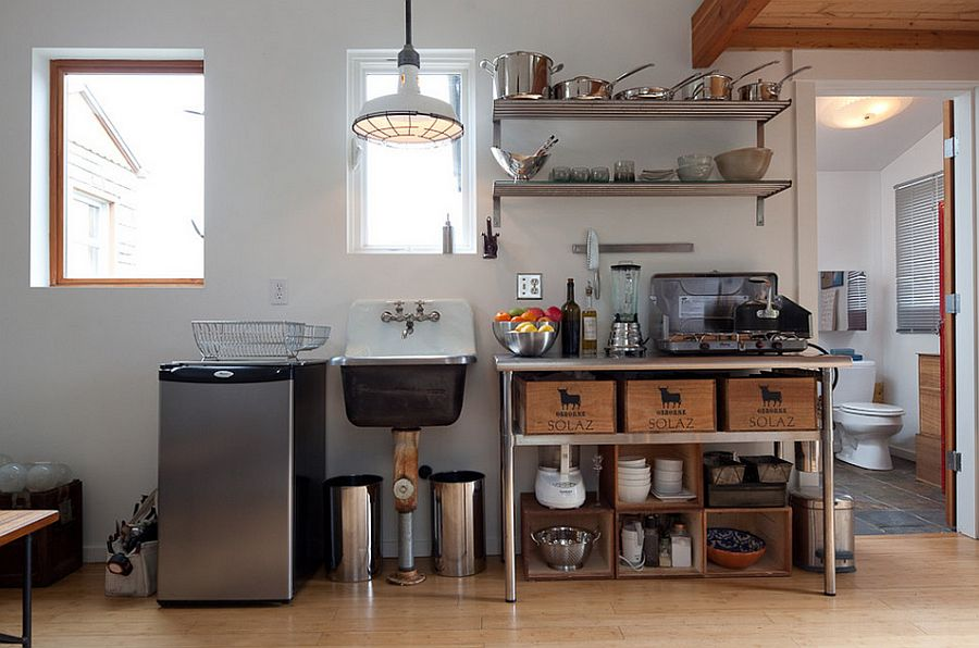 Stainless steel table and shelves for the small kitchen with industrial eclectic look [From: Ira Lippke – New York Times]