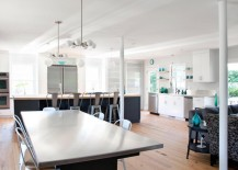 Stainless steel table in a light and airy dining space