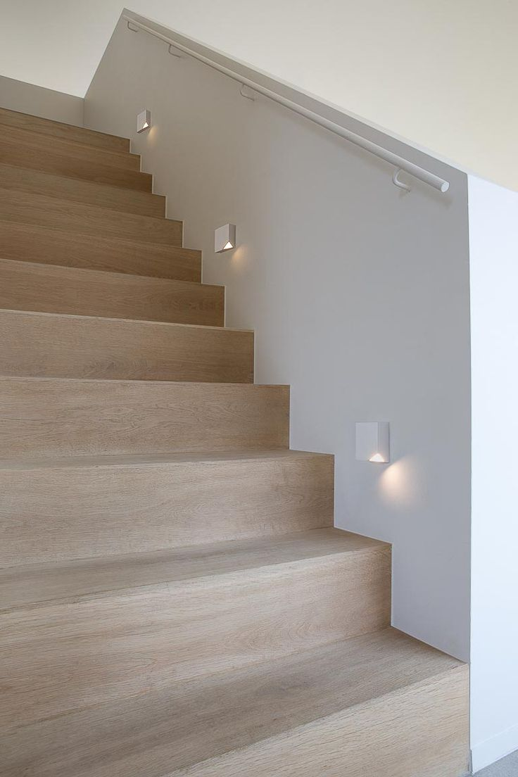 Staircase light fixtures with corners removed to light up the steps