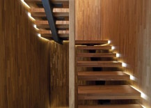 Staircase with lighting along the sides for a floating look