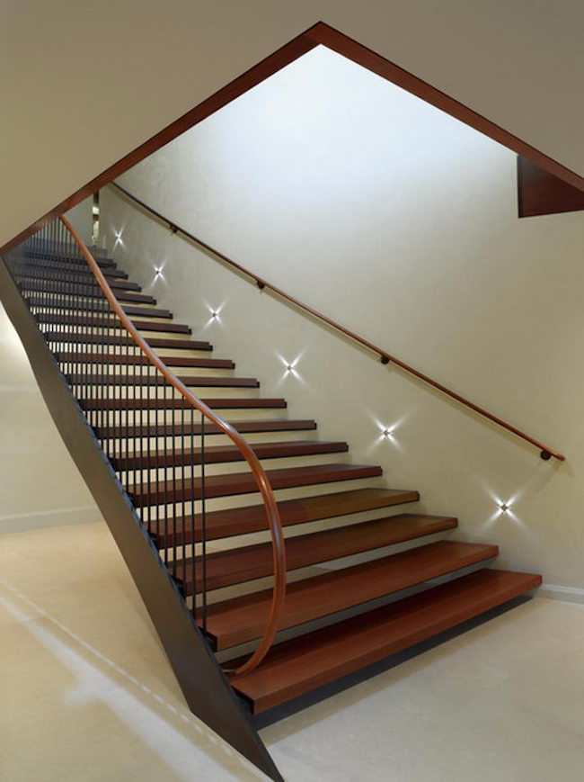 Staircase with star-like lights along the wall