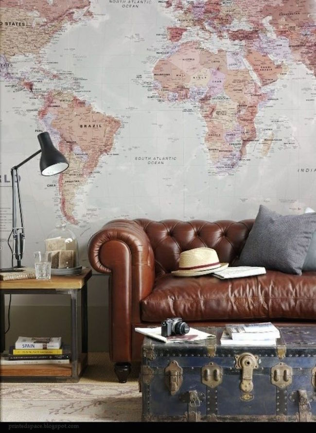 Travel-themed living room with old trunk coffee table