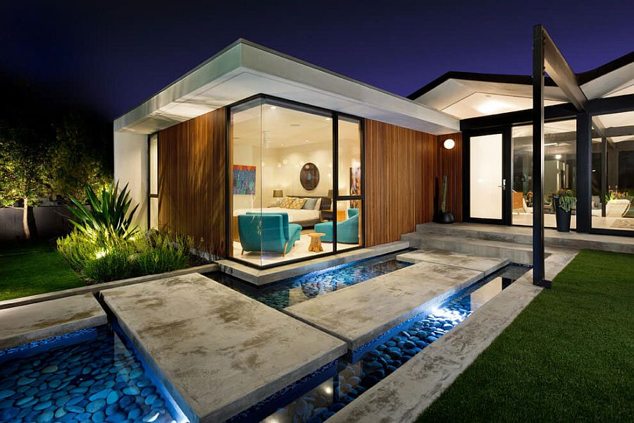 Stepping stones and reflecting pool shape the dazzling entry of the LA Home with ocean views