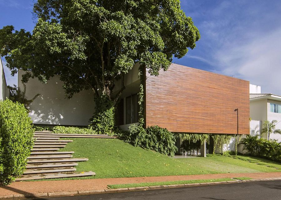 Street view of the RMJ Residence in Brazil with wooden wall