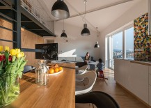 TV-creates-an-optical-boundary-between-kitchen-and-living-area-217x155