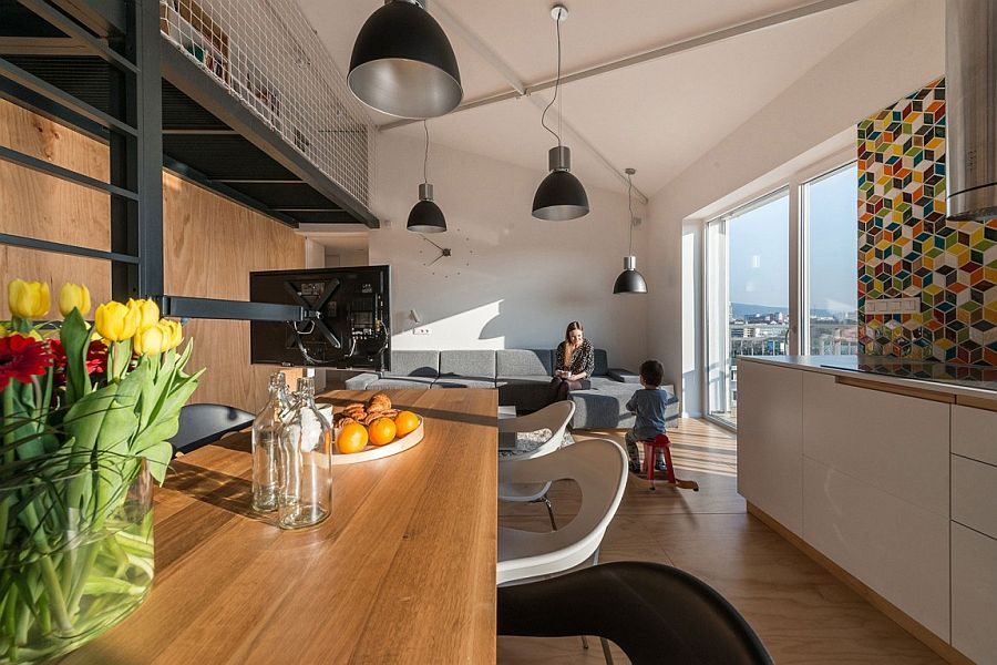 TV creates an optical boundary between kitchen and living area