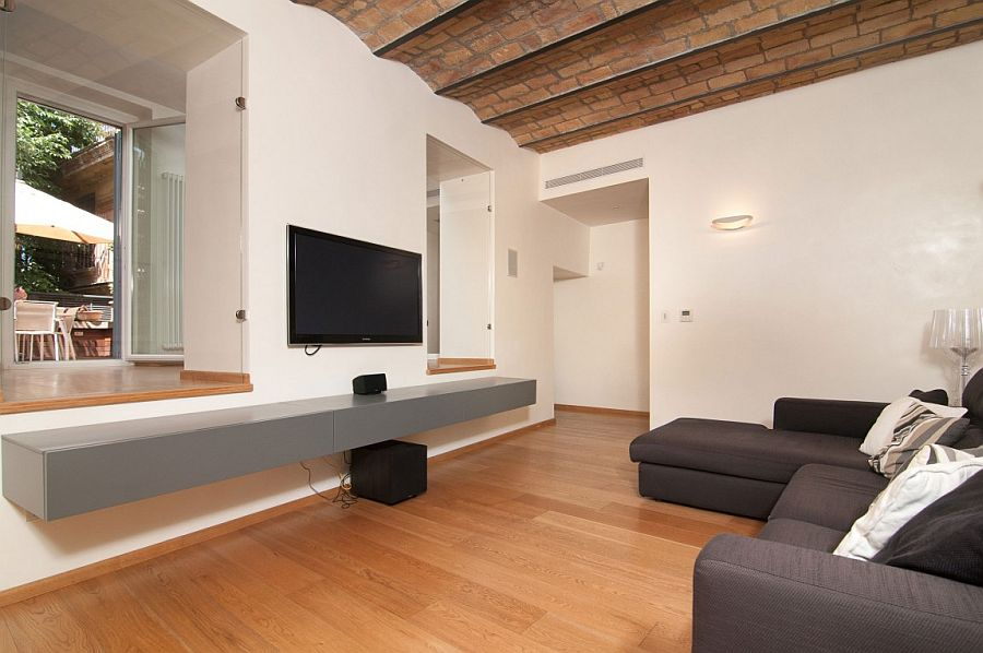 TV room with sleek entertainment unit and plush couch