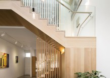 Timber structure with built in seating in the Melbourne living room 217x155 Shaping Your Home Around a Sculptural Staircase: Posh South Melbourne House 2