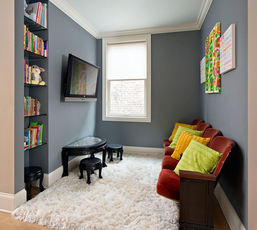 Tiny nook off of the hallway turned into kids' play zone and TV viewing space [Design: Inspired Interiors]