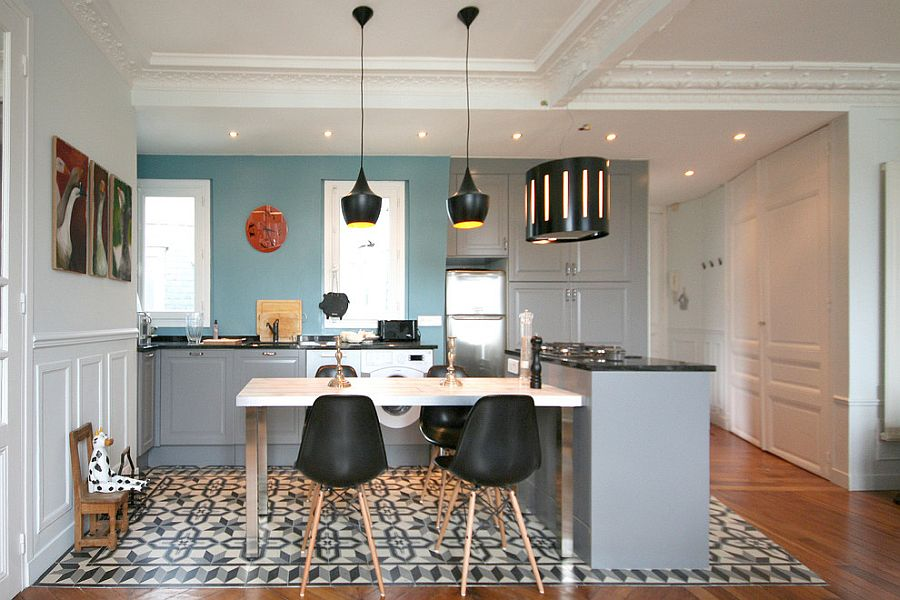 Tom Dixon pendant lights and Eames chairs grace the chic eclectic kitchen [Design: Atelier NoMa]
