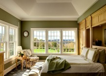 Traditional bedroom in green and white with large windows